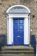 A tipical blue wooden door in Dublin of a victorian house - 222674536