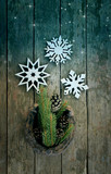 a New Year and Christmas composition with snowflakes , spruce twigs and an old horseshoe over wooden boards - 222686700