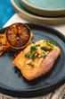 Leinwandbild Motiv Salmon Sole Meuniere with lemon. Fillet of red fish. Steak trout fried with butter, lemon and parsley sauce
