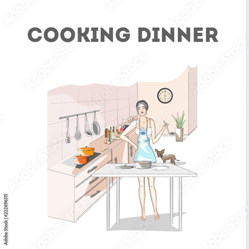 Woman cooking dinner in apron on the kitchen - 222696311