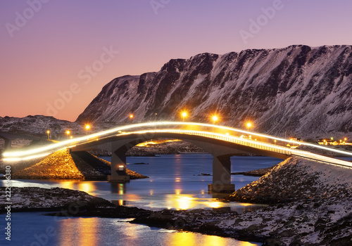 Fridge magnet Bridge and reflection on the water surface. Natural landscape in the Lofoten islands, Norway. Architecture and landscape.