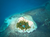 Small island on reef  - 222700947