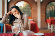 "Постер, картина, фотообои ""Sleepy Woman Yawning while Waiting In a Restaurant"""