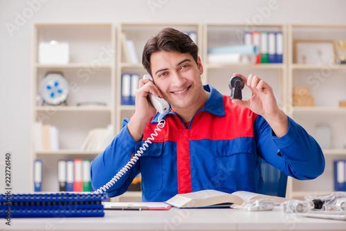 Worker in uniform working on project - 222726140
