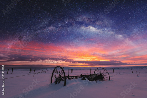 Panoramic winter landscape in sunrise with double exposure night sky landscape