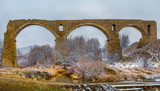 An old railway bridge in the steppe. The German bridge in Russia. History. Ruined and inoperative bridge.