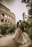 Wedding couple near  Colosseum in Rome, Italy - 222750772