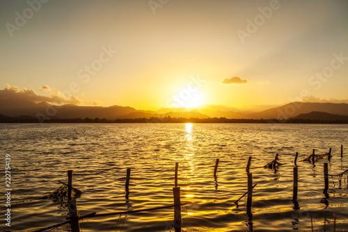 Foto Murales Stagno Colostrai al tramonto