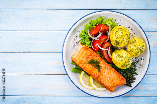 Grilled salmon with boiled potatoes, asparagus and vegetable salad - 222766595