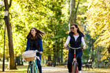 Healthy lifestyle - people riding bicycles in city park - 222768983