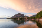 Shining panorama of Lecco Lake at the sunset with huge colorful cloud - 222772392
