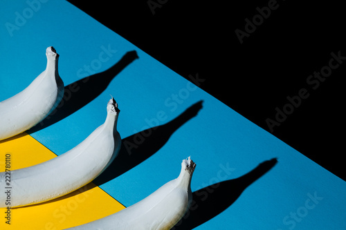White banana on blue and black and yellow background - 222780110