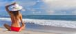 Leinwandbild Motiv Sexy Woman Girl Sitting Sun Hat & Bikini on Beach