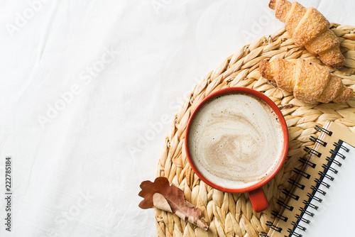Cup of coffe and pastry on white background - 222785184
