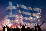 People are looking on fireworks and flag of Greece