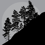 painted silhouette of trees on a mountainside in a gray sky