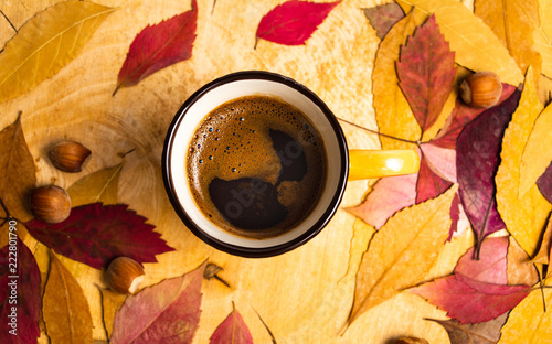 Sticker Cup of coffee in and fallen leaves