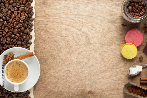Naklejka cup of coffee and beans on wooden background