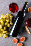 red wine in glasses , bottle of wine , fig, and grape, flat lay view. - 222815968
