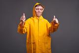 Man in yellow raincoat - 222833762