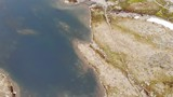 Aerial view. Clear blue water mountain tarn with stone rocky shore. Norwegian nature - 222833770