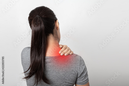 Woman with shoulder pain on white background