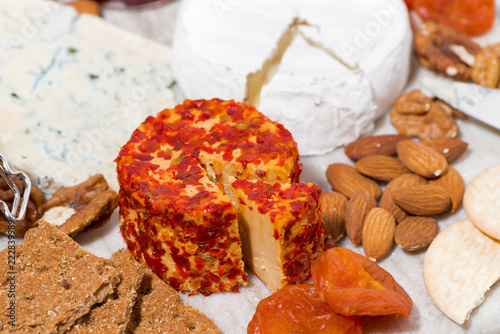 Fototapeta cheese with mold and snacks, top view