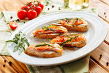 Whole grain bread with avocado paste and salmon decorated with arugula. Top view - 222841756