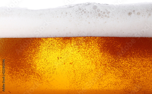 Fototapeta Close up background of beer with bubbles in glass
