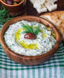 Tzatziki sauce in wooden bowl - 222845185