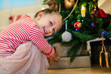 Little girl with Christmas presents - 222850953