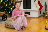 Little girl at home decorated for Christmas - 222850997