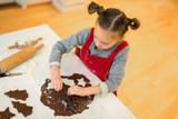Girl baking chocolate cookies - 222851137