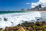Atlantic ocean waves crash against a rocky shore, on a sunny day, near Mirante Copacabana, Rio de Janeiro - 222860529