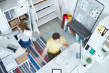 Top view of busy office managers working by desks in studio of design - 222869511