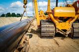 Energiewende - Kräne verlegen eine neue Gaspipeline ins Erdreich - 222875972