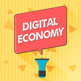 Handwriting text Digital Economy. Concept meaning refers to one that is based on computing technologies. - 222888368