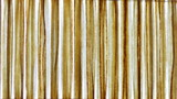extreme abstract close-up of a reed mat in vertical direction