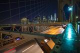 Manhattan skyline at night seen from the illuminated beautiful Brooklyn bridge. New York City, USA. - 222891586