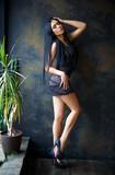 Pretty girl in a sexy short black dress