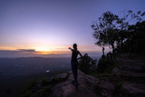 Woman successful hiking climbing silhouette in mountains