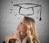 Blonde woman student thinks about her graduation - 222933587