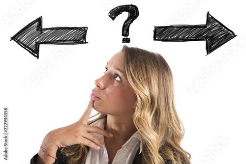 Leinwandbild Motiv Confused businesswoman must choose the right way