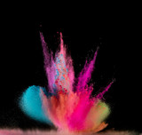 Colored powder explosion on black background. - 222937744