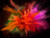 Colored powder explosion on black background. - 222937952