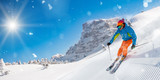 Skier skiing downhill in high mountains - 222939325
