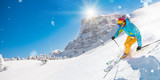 Skier skiing downhill in high mountains - 222939350