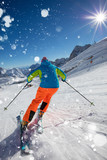 Skier skiing downhill in high mountains - 222939384