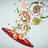 Pieces of delicious japanese sushi frozen in the air. - 222939518