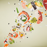 Pieces of delicious japanese sushi frozen in the air. - 222939576
